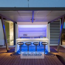 Bar area on roof terrace lit at night