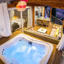 A private luxury space with seating and jacuzzi