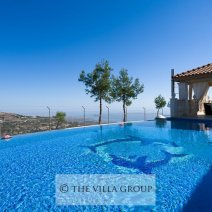 Large private swimming pool with distant sea views