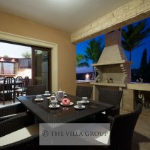 Outdoor dining area with built-in barbecue