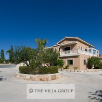 The outside of the villa with large driveway with ample parking