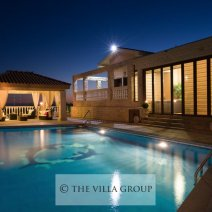 Private swimming pool and gazebo at night