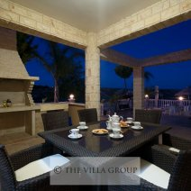 Barbecue and outdoor dining area at night