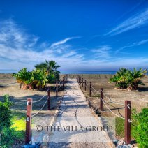 Private walkway from the villa's gardens to the beach