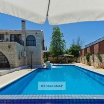 Patios and sunbathing areas border the 14 metre private swimming pool