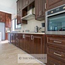 Adjacent to this living area is the fully equipped kitchen offering an oven, hob, fridge/freezer, microwave, water cooler and dishwasher.