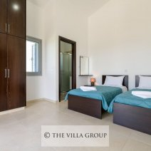 Twin bedroom with access to the shared furnished balcony