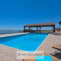 Large furnished patio area and swimming pool