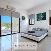 Spacious double bedroom with a private balcony