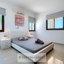 Beautifully furnished double bedroom with an air-conditioning unit