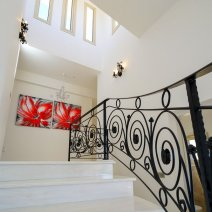 Feature marble staircase with vaulted ceiling