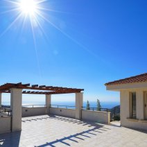 Upper sun terrace with panoramic mountain and sea views