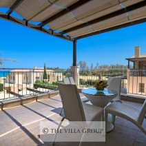 Furnished balcony overlooking the swimming pool and lawn area
