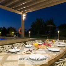 Alfresco dining area adjacent to the swimming pool