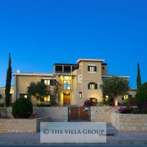 The spacious, gated driveway lies at the front of the villa set in beautiful gardens
