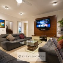 The living area offers a large flat screen TV with UK channels, unlimited movies, sports and music channels