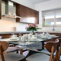 Modern fully equipped kitchen with breakfast table