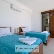 Comfortable twin bedroom with ensuite shower and terrace