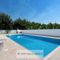 Large private swimming pool with sun loungers